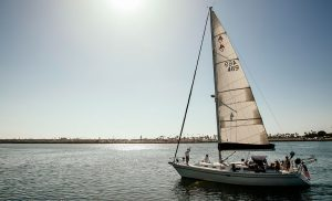 Venere Sailboat on Costal Waters with Group Of People